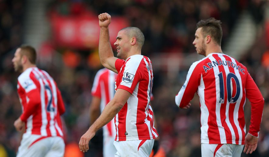 Stoke City's Jonathan Walters celebrates scoring the first goal of the game during their English Premier League soccer match against Queen's Park Rangers at The Britannia Stadium, Stoke-on-Trent, England, Saturday, Jan. 31, 2015. (AP Photo/Dave Thompson, PA Wire)      UNITED KINGDOM OUT     -     NO SALES     -     NO ARCHIVES