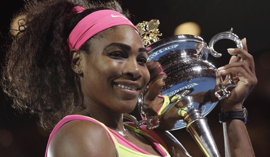 Serena Williams of the U.S. holds the trophy after defeating Maria Sharapova of Russia in the women's singles final at the Australian Open tennis championship in Melbourne, Australia, Saturday, Jan. 31, 2015. (AP Photo/Bernat Armangue)