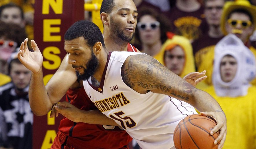 Minnesota forward Maurice Walker (15) drives against Nebraska forward Walter Pitchford, rear, during the first half of an NCAA college basketball game in Minneapolis, Saturday, Jan. 31, 2015.  (AP Photo/Ann Heisenfelt)