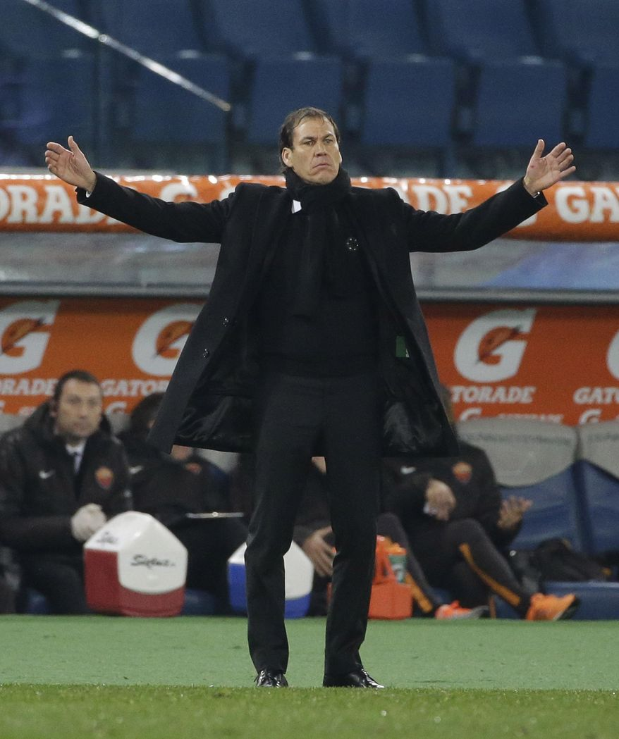 Roma coach Rudi Garcia calls out to his players during a Serie A soccer match between Roma and Empoli, at Rome's Olympic Stadium, Saturday, Jan. 31, 2015. (AP Photo/Andrew Medichini)