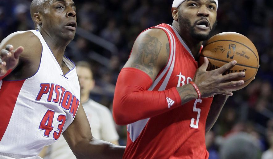 Houston Rockets' Josh Smith (5) drives to the basket past Detroit Pistons' Anthony Tolliver (43) during the first half of an NBA basketball game Saturday, Jan. 31, 2015, in Auburn Hills, Mich. (AP Photo/Duane Burleson)