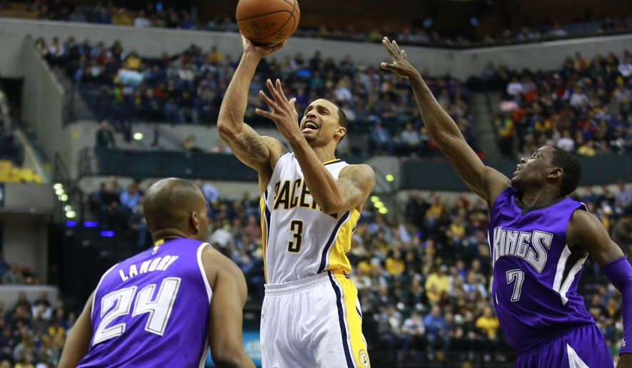 Indiana Pacers guard George Hill (3) shoots between Sacramento Kings forward Carl Landry (24) and Kings guard Darren Collison during the second half of an NBA basketball game, Saturday, Jan. 31, 2015, in Indianapolis. Sacramento won 99-94. (AP Photo/R Brent Smith)