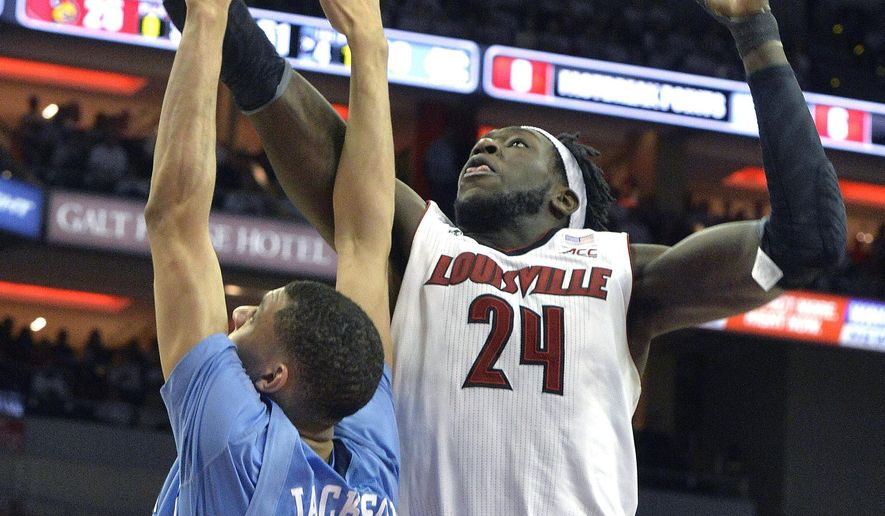Louisville's Montrezl Harrell, right, grabs a rebound away from North Carolina's Justin Jackson during the second half of their NCAA college basketball game, Saturday, Jan. 31, 2015 in Louisville, Ky. Louisville won 78-68. (AP Photo/Timothy D. Easley)