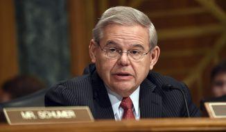 Sen. Robert Menendez, New Jersey Democrat, speaks on Capitol Hill in Washington on Jan. 27, 2015. (Associated Press) **FILE**
