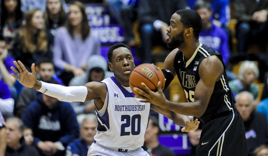 Northwestern guard Scottie Lindsey (20) defends Purdue guard Rapheal Davis (35) during the first half of an NCAA college basketball game Saturday, Jan. 31, 2015, in Evanston, Ill. (AP Photo/Matt Marton)