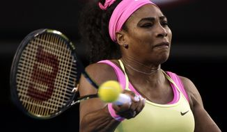 Serena Williams of the U.S. makes a forehand return to Maria Sharapova of Russia during the women's singles final at the Australian Open tennis championship in Melbourne, Australia, Saturday, Jan. 31, 2015. (AP Photo/Vincent Thian)