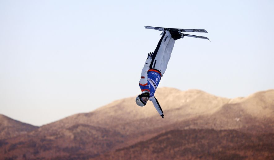 Zhou Hang, of China, competes in the men's freestyle World Cup aerials competition on Saturday, Jan. 31, 2015, in Lake Placid, N.Y. (AP Photo/Mel Evans)