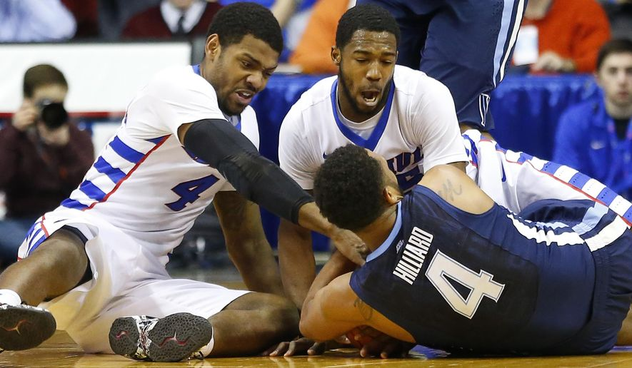 DePaul forward Myke Henry, left, DePaul guard Durrell McDonald, right, and Villanova guard Darrun Hilliard II (4) scramble for the ball during the first half of an NCAA college basketball game, Saturday, Jan. 31, 2015, in Rosemont, Ill. (AP Photo/Jeff Haynes)