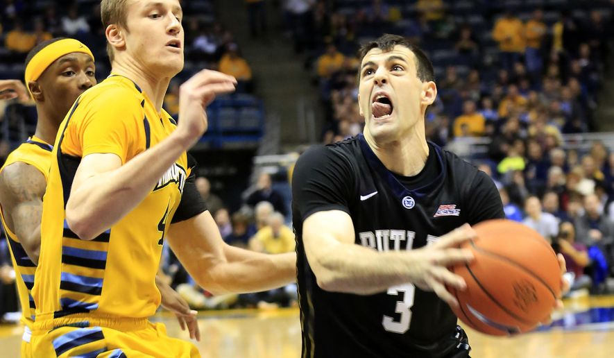 Butler guard Alex Barlow, right, drives to the basket against Marquette center Luke Fischer, left, during the second half of an NCAA college basketball game Saturday, Jan. 31, 2015, in Milwaukee. (AP Photo/Darren Hauck)