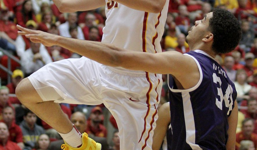 Iowa State forward Georges Niang drives past TCU forward Kenrich Williams during the first half of an NCAA college basketball game, Saturday, Jan. 31, 2015, in Ames, Iowa. (AP Photo/Justin Hayworth)
