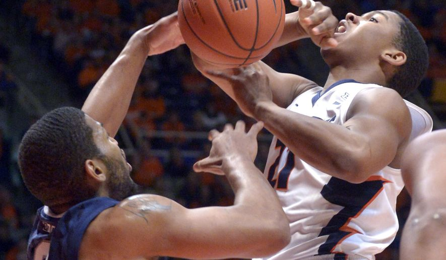 Illinois' guard Malcolm Hill (21) goes up against Penn State's guard D.J. Newbill (2) during the first half of an NCAA college basketball game, Saturday, Jan. 31, 2015, in Champaign, Ill. (AP Photo/Robin Scholz)