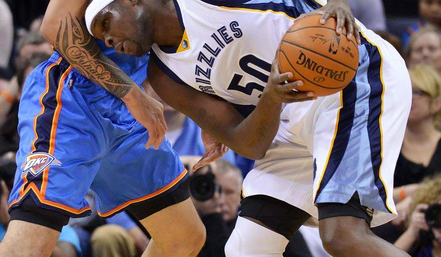 Memphis Grizzlies forward Zach Randolph (50) challenges Oklahoma City Thunder center Steven Adams for position in the first half of an NBA basketball game Saturday, Jan. 31, 2015, in Memphis, Tenn. (AP Photo/Brandon Dill)