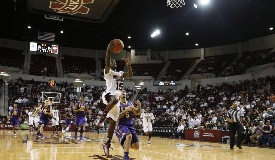 Mississippi State guard I.J. Ready (15) leaps past LSU guard Josh Gray (5) for a layup in the second half of a NCAA college basketball game in Starkville, Miss., Saturday, Jan. 31, 2015. Mississippi State won 73-67. (AP Photo/Rogelio V. Solis)