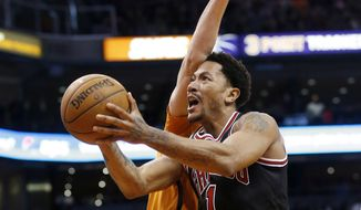 Chicago Bulls' Derrick Rose, right, is fouled by Phoenix Suns' Alex Len during the first half of an NBA basketball game Friday, Jan. 30, 2015, in Phoenix. (AP Photo/Ross D. Franklin)