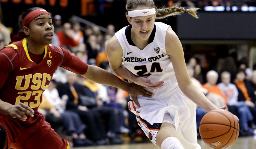 Oregon State guard Sydney Wiese, right, drives on Southern California forward Drew Edelman during the first half of an NCAA college basketball game in Corvallis, Ore., Saturday, Jan. 31, 2015. (AP Photo/Don Ryan)