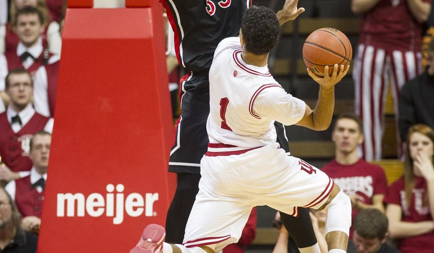Indiana guard James Blackmon Jr. (1) drives to the basket against Rutgers forward Greg Lewis (35) during the first half of an NCAA college basketball game, Saturday, Jan. 31, 2015, in Bloomington, Ind. (AP Photo/Doug McSchooler)