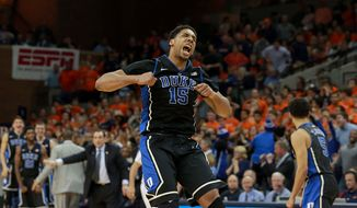 Duke's Jahlil Okafor (15) celebrates as the team leads Virginia late in the second half of an NCAA college basketball game in Charlottesville, Va., on Saturday, Jan. 31, 2015. Duke won 69-63. (AP Photo/Richmond Tiimes-Dispatch, Daniel Sangjib Min)