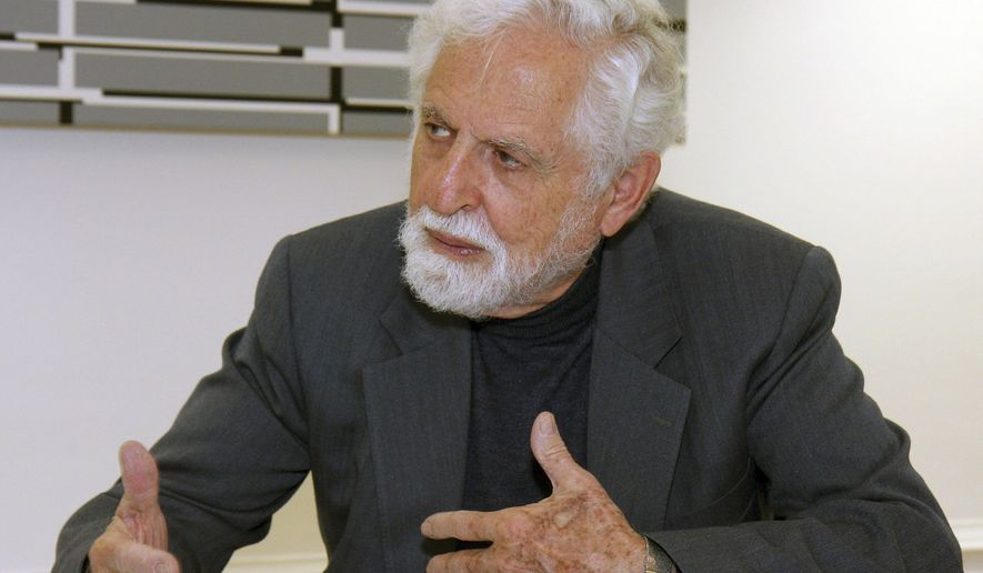 "FILE - In this Oct. 20, 2009 file photo, Carl Djerassi talks to Austrian Chancellor Werner Faymann, not seen, at the federal chancellery in Vienna, Austria. Djerassi, the chemist widely considered the father of the birth control pill, has died of complications of cancer in his San Francisco home, Stanford University spokesman Dan Stober said. He was 91. Djerassi, a professor emeritus of chemistry at Stanford, was most famous for leading a research team in Mexico City that in 1951 developed norethindrone, a synthetic molecule that became a key component of the first birth control pill. ""The pill"" as it came to be known radically transformed sexual practices and women's lives. (AP Photo/Ronald Zak, File)"