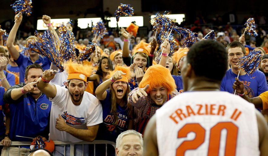Florida guard Michael Frazier II (20) celebrates with the student section fter their 57-56 win over Arkansas in an NCAA college basketball game at the Stephen C. O'Connell Center, Saturday, Jan. 31, 2015, in Gainesville, Fla. (AP Photo/The Gainesville Sun, Matt Stamey)  THE INDEPENDENT FLORIDA ALLIGATOR OUT