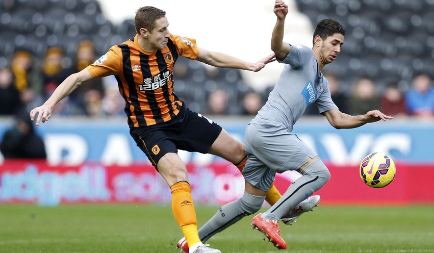 Hull City's Michael Dawson, left,  and Newcastle United's Ayoze Perez  battle for the ball during their English  Premier League match at the KC Stadium, Hull England Saturday Jan. 31, 2015. (AP Photo/Lynne Cameron/PA) UNITED KINGDOM OUT