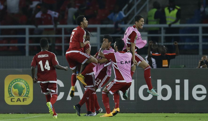 Equatorial Guinea's players celebrate a goal during their African Cup of Nations quarter final soccer match against Tunisia in Bata, Equatorial Guinea, Saturday, Jan. 31, 2015. (AP Photo/Themba Hadebe)