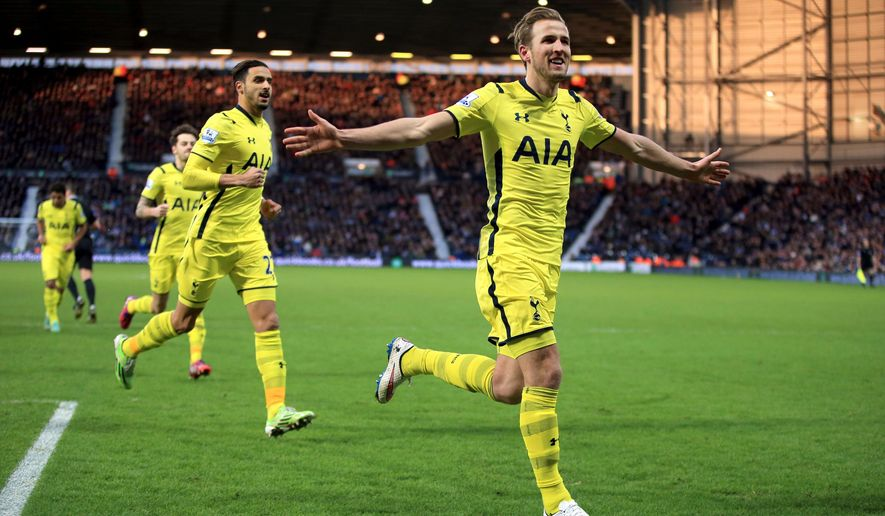 Tottenham Hotspur's Harry Kane celebrates scoring his sides third goal of the game against West Bromwich during their English Premier League match at The Hawthornes,  West Bromwich England, Saturday Jan. 31, 2015. (AP Photo/Nick Potts/PA) UNITED KINGDOM OUT