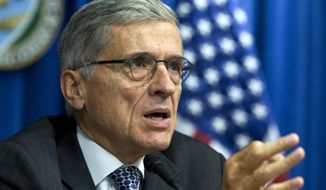 Federal Communications Commission (FCC) Chairman Tom Wheeler speaks during new conference in Washington in this Oct. 8, 2014, file photo. (AP Photo/Jose Luis Magana)
