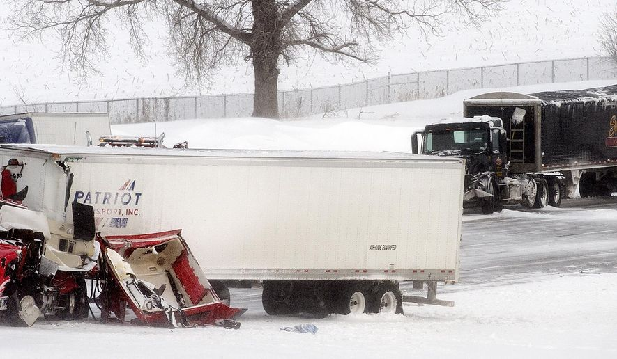 A collision between two semi-trailer trucks on westbound Interstate 80 near exit 405 forced the closure of the highway on Sunday, Feb. 1, 2015, in Lincoln, Neb. (AP Photo/The Journal-Star, Francis Gardler) LOCAL TV OUT; KOLN-TV OUT; KGIN-TV OUT; KLKN-TV OUT