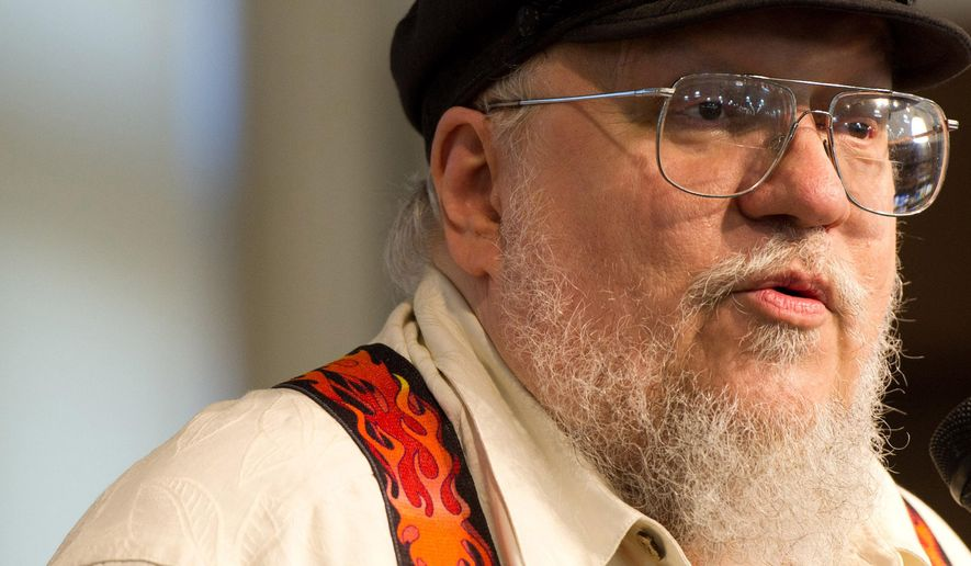 """FILE - In this July 14, 2011 file photo, author George R.R. Martin attends a book signing for """"A Dance with Dragons"""" at Barnes & Noble in New York.  Martin is now a famous author who has the clout to go to the Super Bowl. Martin attended the Rolling Stone party Saturday Jan. 31, 2015 on the eve of the Super Bowl and plans to attend the game Sunday, his first ever trip to the big game. (AP Photo/Charles Sykes, File)"""
