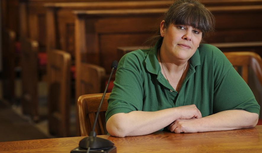 In this photo taken on Thursday, Jan. 15, 2015, Vicki Nicholls of Green Bay poses for a portrait inside the Manitowoc County Courthouse circuit court branch 3 courtroom in Manitowoc, Wis. Nicholls is participating in a program which substitutes traditional punishments with alternative treatments. (AP Photo/Herald Times Reporter, Matthew Apgar)