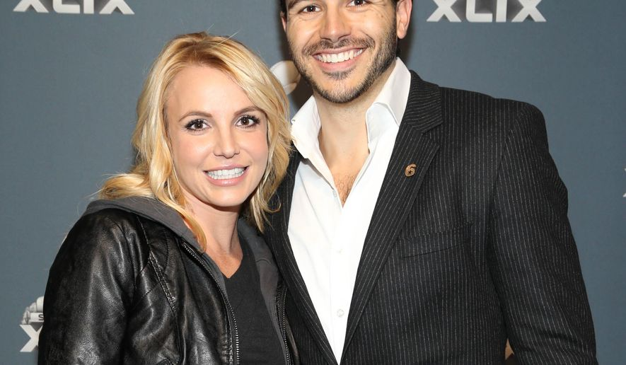 Britney Spears and Charlie Ebersol arrive at the Super Bowl XLIX red carpet on Sunday, Feb. 1, 2015 in Glendale, Ariz. (Photo by Omar Vega/Invision/AP)