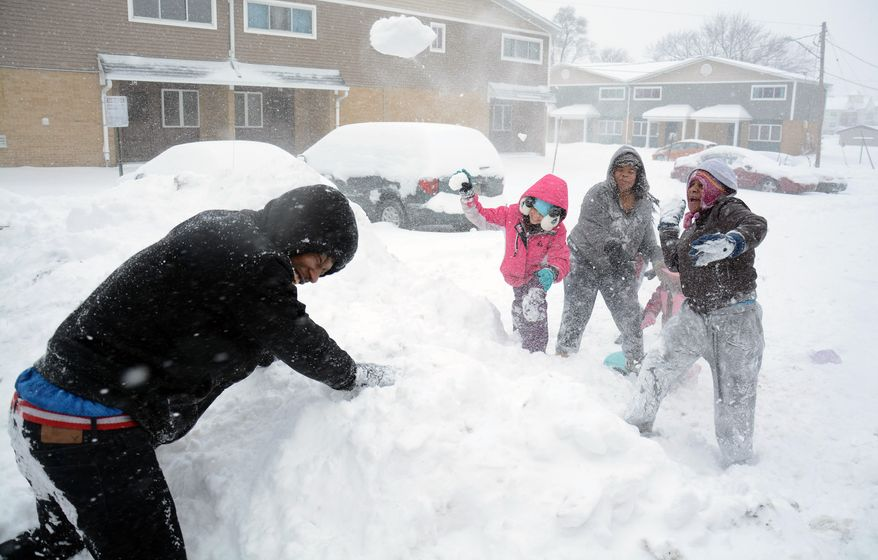 Adren Jefferson, left, Takia Griffin, second from right, Ivory Griffin, right, and Soraya Rodriguez, 9, have a snowball fight at Washington Gardens in Elkhart, Ind., Sunday, Feb. 1, 2015. A slow-moving winter storm blanketed a large swath of the Plains and Midwest in snow Sunday, forcing the cancellation of more than 1,500 flights and making roads treacherous. (AP Photo/The Elkhart Truth, Sarah Welliver) GOSHEN NEWS OUT