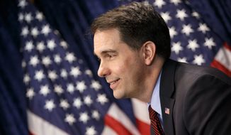 Republican Wisconsin Gov. Scott Walker to be best positioned to take advantage of the wide-open field following Mitt Romney's decision not to run for president, after a Des Moines Register poll showed him leading the pack among possible candidates at 15 percent. (Associated Press)