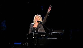 Christine McVie, 71, who has spent the past decade and a half at her home in Kent, England, was clearly joyous to be back with her old bandmates. (Associated Press)