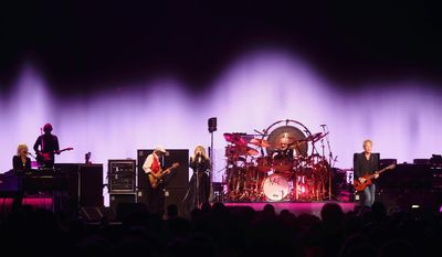 "Christine McVie, John McVie, Stevie Nicks, Mick Fleetwood, Lindsey Buckingham (left to right) of Fleetwood Mac performed Friday at the Verizon Center on the latest leg of its ""On With the Show"" tour. The group celebrated, not only for reaching a four-decade milestone but also for the return of keyboardist/vocalist Miss McVie. (Associated Press)"