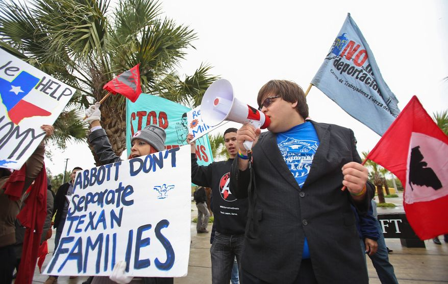 Protesters gathered outside the federal courthouse in Brownsville, Texas, to chant, read poems and share stories of their immigrations struggles. The leading immigration court case on President Obama's deportation amnesty has turned into a wild affair. (Associated Press)