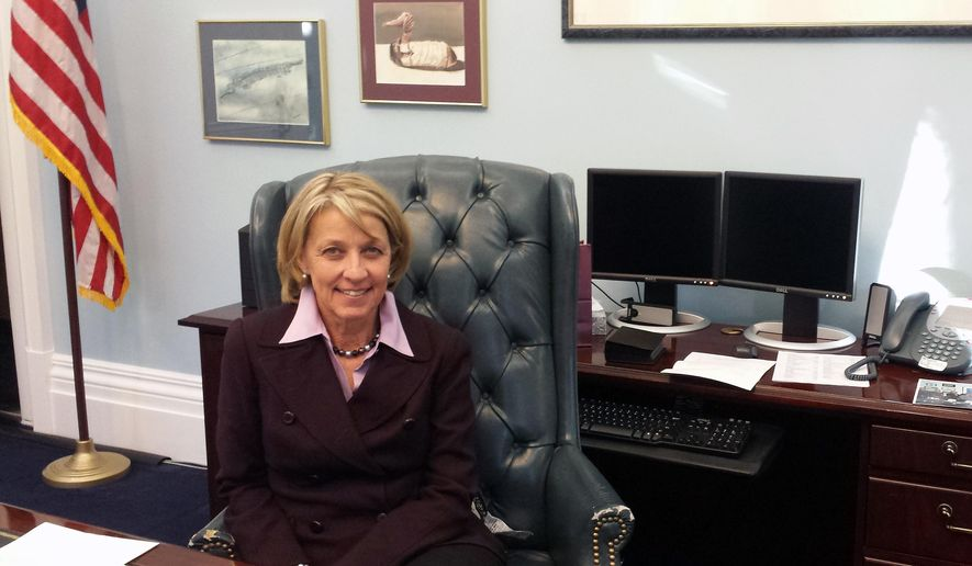 In this Jan. 13, 2015 photo, Secretary of State Barbara Cegavske poses for a photo in her office in Carson City, Nev. Cegavske knows her way around the statehouse in Carson City after spending 18 years in the Nevada Legislature. But her recent promotion to Secretary of State, Nevada's third highest-ranking constitutional office, means an upgrade to prime State Capitol space and a new platform for advancing her priorities. (AP Photo/Michelle Rindels)
