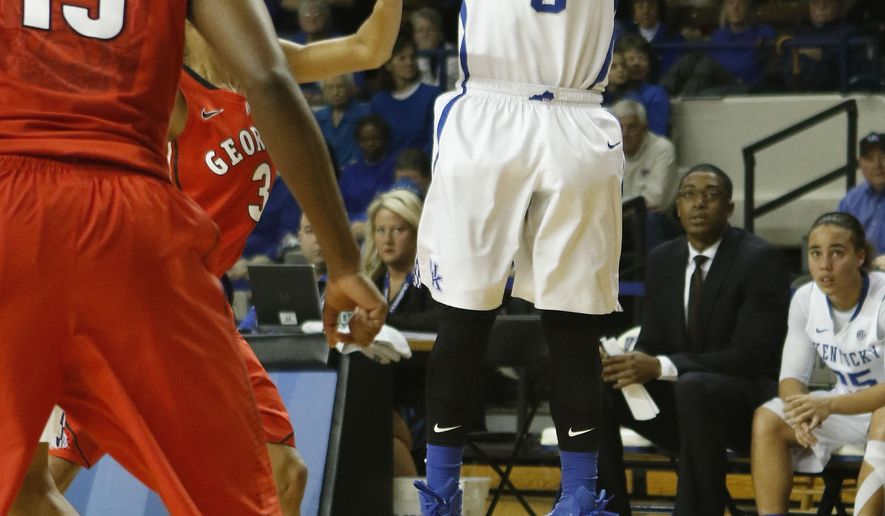 Kentucky's Jennifer O'Neill (0) shoots a 3-pointer during the second half of an NCAA college basketball game against Georgia, Sunday, Feb. 1, 2015, in Lexington, Ky. Kentucky won 80-72. (AP Photo/James Crisp)