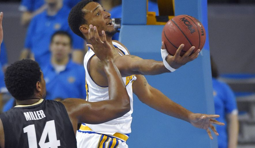 UCLA guard Norman Powell, right, puts up a shot as Colorado forward Tory Miller defends during the first half of an NCAA college basketball game, Saturday, Jan. 31, 2015, in Los Angeles. (AP Photo/Mark J. Terrill)