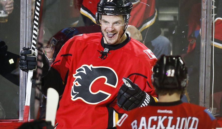 Calgary Flames' Lance Bouma celebrates his goal with teammates during the third period of an NHL hockey game against the Edmonton Oilers on Saturday, Jan. 31, 2015, in Calgary, Alberta. (AP Photo/The Canadian Press, Jeff McIntosh)