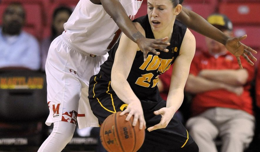 Maryland guard Laurin Mincy, left, pressures Iowa guard Samantha Logic during the first half of  an NCAA college basketball game Sunday, Feb. 1, 2015 in College Park, Md.(AP Photo/Gail Burton)