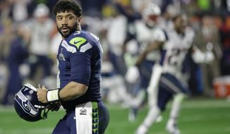 Seattle Seahawks quarterback Russell Wilson (3) looks back after throwing an interception to New England Patriots strong safety Malcolm Butler during the second half of NFL Super Bowl XLIX football game Sunday, Feb. 1, 2015, in Glendale, Ariz. (AP Photo/David Goldman) ** FILE **