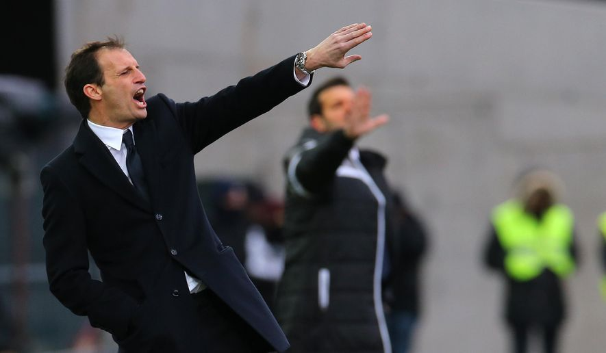 Juventus' coach Massimiliano Allegri gives instructions to his players during the Serie A soccer match between Udinese and Juventus at the Friuli Stadium in Udine, Italy, Sunday, Feb. 1, 2015. (AP Photo/Paolo Giovannini)