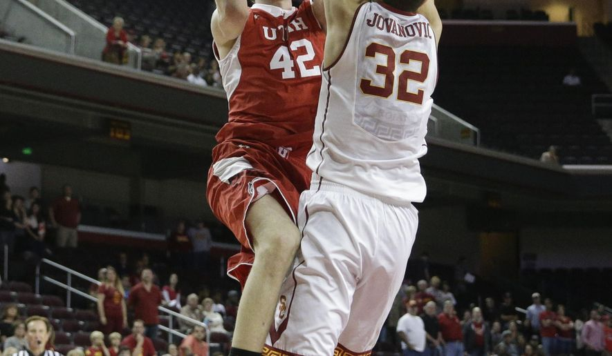 Utah's Jakob Poeltl, left, of Austria, shoots under pressure by Southern California's Nikola Jovanovic, of Serbia, during the first half of an NCAA college basketball game, Sunday, Feb. 1, 2015, in Los Angeles. (AP Photo/Jae C. Hong)