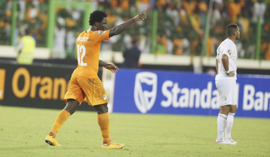 Ivory Coast's Wilfried Bony, left, celebrates after he scored a goal during their African Cup of Nations quarter final soccer match with Algeria at the Estadio De Malabo, Equatorial Guinea, Sunday, Feb. 1, 2015. (AP Photo/Sunday Alamba)