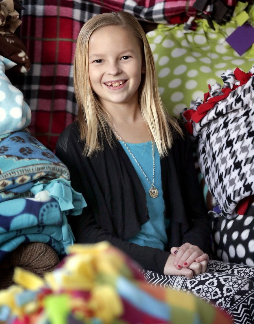 Aubree Leitermann, 10, creates fleece blankets that are given to veterans using Express Air Medical Transport.  on Jan. 22, 2015, in Kimberly, Wis. She has made over a 100 of the blankets since she started in late November of 2014. (AP Photo/The Post-Crescent, Wm.Glasheen)
