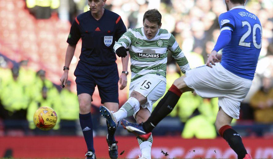 Celtic's Kris Commons, centre,  scores his team's second goal during the Scottish League Cup, semifinal at Hampden Park, Glasgow.  Scotland, Sunday Feb. 1, 2015. (AP Photo/Owen Humphreys/PA) UNITED KINGDOM OUT