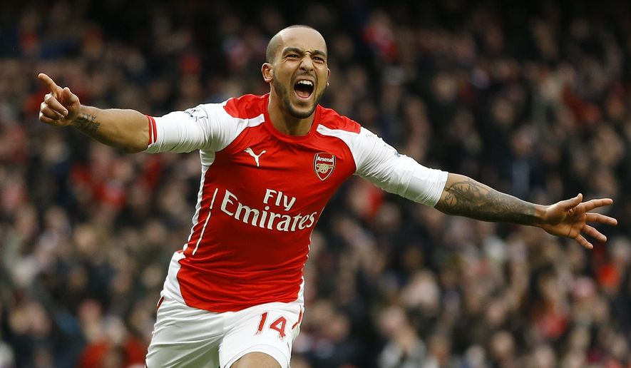 Arsenal's Theo Walcott celebrates scoring a goal during the English Premier League soccer match between Arsenal and Aston Villa at the Emirates stadium in London, Sunday, Feb. 1, 2015. (AP Photo/Kirsty Wigglesworth)