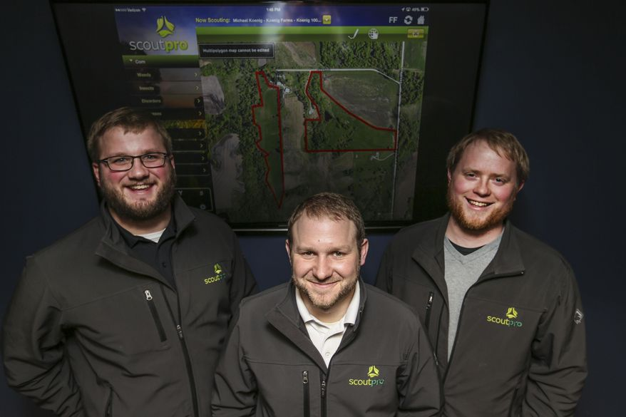 FOR RELEASE SUNDAY, FEBRUARY 1, 2015, AT 12:01 A.M. CST. - In this photo taken on Jan. 22, 2015, from left, Stuart Mcculloh, Michael Koenig and Holden Nyhus, the founders of ScoutPro an agricultural application and software company which they created while students at Iowa Sate University in 2010, pose in their offices in Urbandale, Iowa.  (AP Photo/The Des Moines Register, Kelsey Kremer )  MAGS OUT, TV OUT, NO SALES, MANDATORY CREDIT