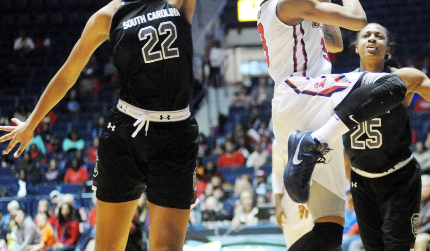 South Carolina's A'ja Wilson (22) blocks a shot by Mississippi's A'Queen Hayes during their NCAA college basketball game, Sunday, Feb. 1, 2015, in Oxford, Miss. (AP Photo/Oxford Eagle, Bruce Newman)